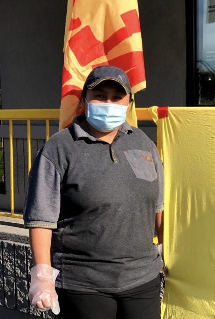 Maria Sabina stands in front of the McDonald's location she works at on Friday, January 15, 2021.