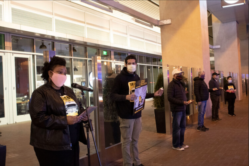 App workers protest outside Uber's headquarters.